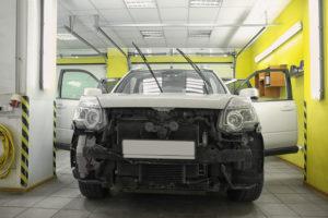 Damaged car in repair shop